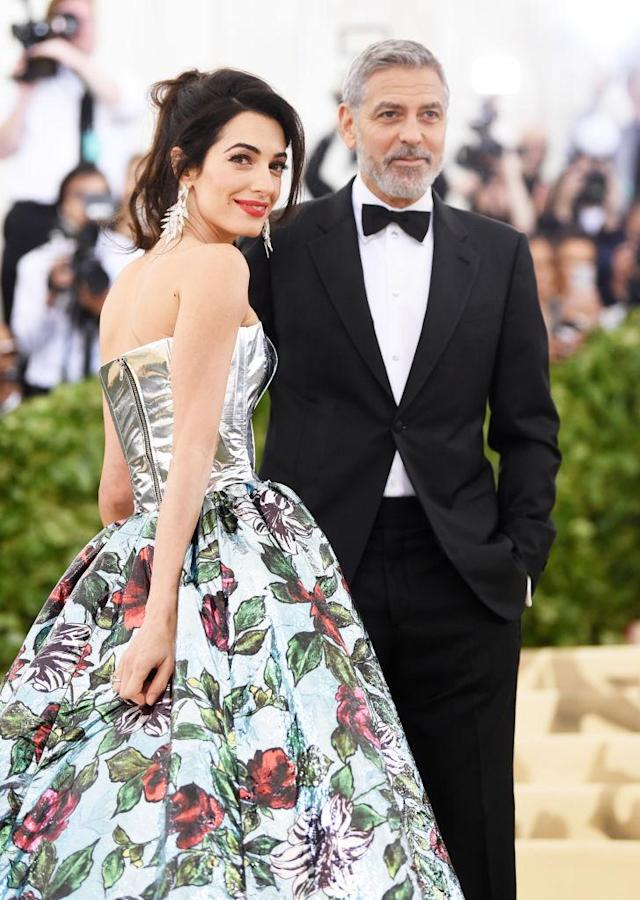 "Amal Clooney and George Clooney walk the red carpet at the ""Heavenly Bodies: Fashion & The Catholic Imagination"" Costume Institute Gala at the Metropolitan Museum of Art on May 7, 2018 in New York City. (Photo: Jamie McCarthy/Getty Images)"