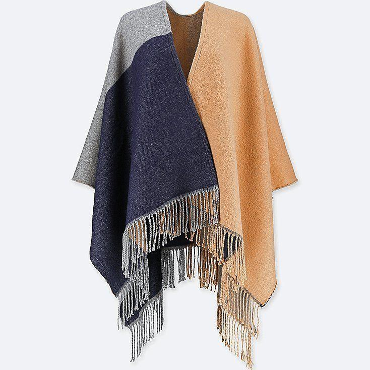 """Versatility reigns supreme for travelers. This stole can also be used as a chunky scarf or even a wrap or blanket. <strong><a href=""""https://www.uniqlo.com/us/en/women-windowpane-2-way-stole-408917COL30SIZ999000.html"""" target=""""_blank"""" rel=""""noopener noreferrer"""">Get it here</a></strong>."""