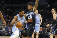Minnesota Timberwolves' Malik Beasley, left, drives past Orlando Magic's Markelle Fultz in the second half of an NBA basketball game, Friday, March 6, 2020 in Minneapolis. (AP Photo/Jim Mone)