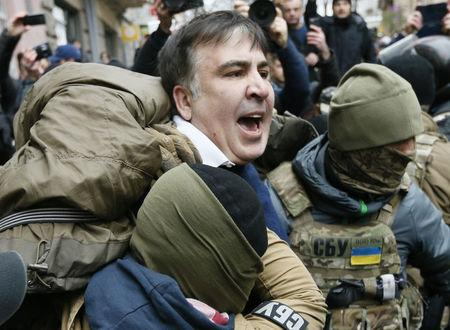 Georgian former President Mikheil Saakashvili is detained by officers of the Security Service of Ukraine conducting a search of his apartment in Kiev