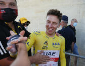 Slovenia's Tadej Pogacar, wearing the overall leader's yellow jersey, celebrates after the twentieth stage of the Tour de France cycling race, an individual time-trial over 30.8 kilometers (19.1 miles) with start in Libourne and finish in Saint-Emilion, France,Saturday, July 17, 2021. (Tim van Wichelen/Pool Photo via AP)
