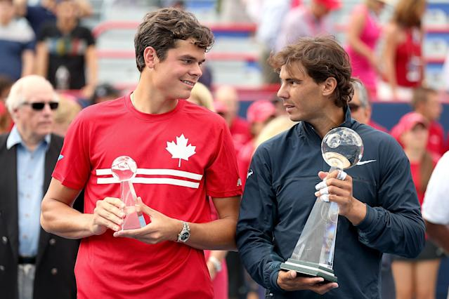 MONTREAL, QC - AUGUST 11: Milos Roanic of Canada and Rafael Nadal of Spain poses for photographers during the trophy ceremony after the final of the Rogers Cup at Uniprix Stadium on August 11, 2013 in Montreal, Quebec, Canada. (Photo by Matthew Stockman/Getty Images)