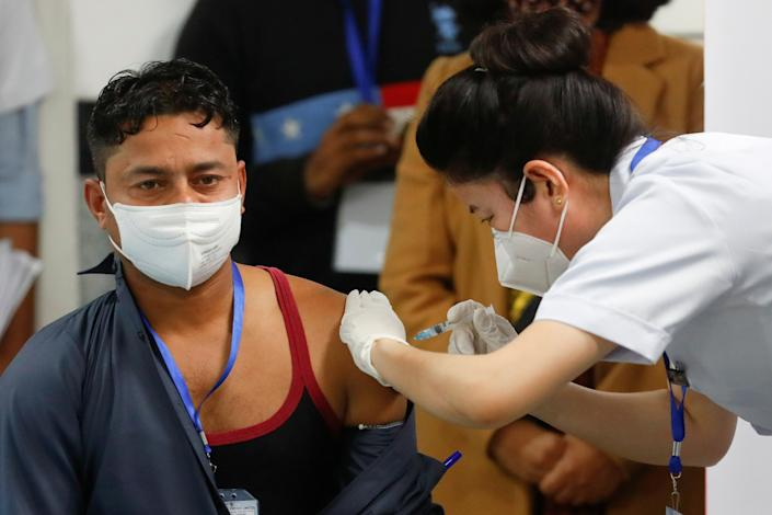<p>Mukesh Kumar, a sanitation worker at All India Institute of Medical Science (AIIMS) was the first person to get coronavirus vaccine in India</p> (REUTERS)