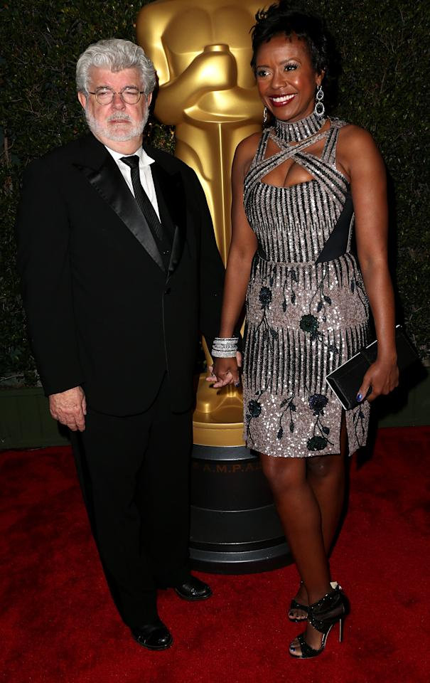 HOLLYWOOD, CA - DECEMBER 01:  Producer George Lucas (L) and his wife Mellody Hobson attend the Academy Of Motion Picture Arts And Sciences' 4th Annual Governors Awards at Hollywood and Highland on December 1, 2012 in Hollywood, California.  (Photo by Frederick M. Brown/Getty Images)