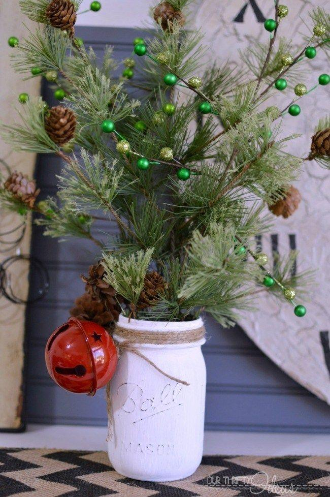 """<p>Gather some pine branches and pine cones for this easy DIY Mason jar craft that looks like a mini Christmas tree.</p><p><strong>Get the tutorial at <a href=""""http://www.ourthriftyideas.com/2014/11/diy-faux-spring-christmas-tree-mason-jar-decor.html#.VGy8Fr6q820&_a5y_p=2873500"""" rel=""""nofollow noopener"""" target=""""_blank"""" data-ylk=""""slk:Our Thrifty Ideas"""" class=""""link rapid-noclick-resp"""">Our Thrifty Ideas</a>.</strong></p><p><strong><a class=""""link rapid-noclick-resp"""" href=""""https://www.amazon.com/Apple-Barrel-Acrylic-Assorted-21119/dp/B0018N4P54/ref=sxin_0_ac_d_pm?tag=syn-yahoo-20&ascsubtag=%5Bartid%7C10050.g.2132%5Bsrc%7Cyahoo-us"""" rel=""""nofollow noopener"""" target=""""_blank"""" data-ylk=""""slk:SHOP ACRYLIC PAINT"""">SHOP ACRYLIC PAINT</a><br></strong></p>"""