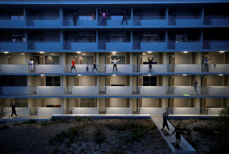 esidents exercise on their balconies following fitness trainers in Nantes