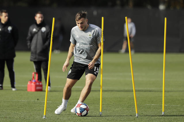 Seattle Sounders forward Jordan Morris dribbles the ball during a training session Friday, Nov. 8, 2019, in Tukwila, Wash. The Sounders are scheduled to face Toronto FC on Sunday in the MLS Cup soccer match in Seattle, the third time the two teams will have met for the MLS championship. (AP Photo/Ted S. Warren)