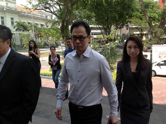 Former CNB director Ng Boon Gay, seen here accompanied by his wife Yap Yen Yen, is at the centre of a high-profile sex-for-contracts corruption trial. (Yahoo! file photo/Jeanette Tan)