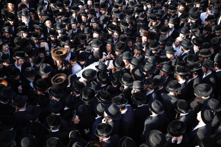 Mourners carry the body of Shragee Gestetner, a Canadian singer who died during Lag BaOmer celebrations at Mt. Meron in northern Israel, at his funeral in Jerusalem on Friday, April 30, 2021. A stampede at a religious festival attended by tens of thousands of ultra-Orthodox Jews in northern Israel killed dozens of people and injured about 150 others early Friday, medical officials said. It was one of the country's deadliest civilian disasters. (AP Photo/Ariel Schalit)