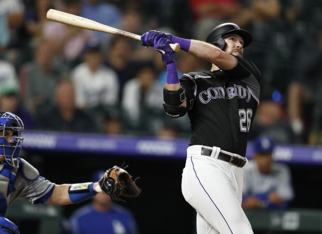 Colorado Rockies' David Dahl follows the flight of his two-run home run against the Los Angeles Dodgers in the eighth inning of a baseball game Monday, July 29, 2019, in Denver. (AP Photo/David Zalubowski)