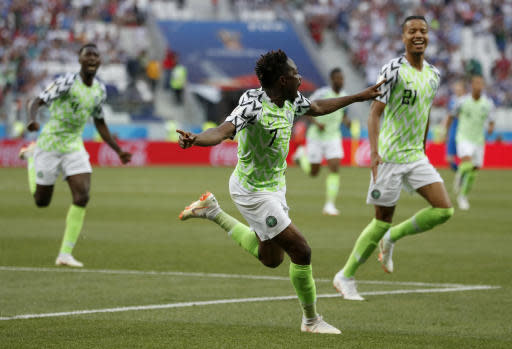 Nigeria's Ahmed Musa, centre, celebrates after scoring his team's first goal during the group D match between Nigeria and Iceland at the 2018 soccer World Cup in the Volgograd Arena in Volgograd, Russia, Friday, June 22, 2018. (AP Photo/Darko Vojinovic)
