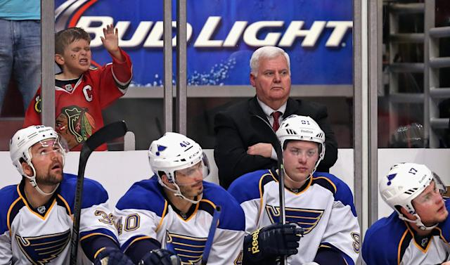 CHICAGO, IL - APRIL 27: A young fan pounds on the glass as head coach Ken Hitchcock of the St. Louis Blues watches the finals minutes along with team members on the bench against the Chicago Blackhawks in Game Six of the First Round of the 2014 NHL Stanley Cup Playoffs at the United Center on April 27, 2014 in Chicago, Illinois. The Blackhawks defeated the Blues 5-1 to win the series four games to two. (Photo by Jonathan Daniel/Getty Images)