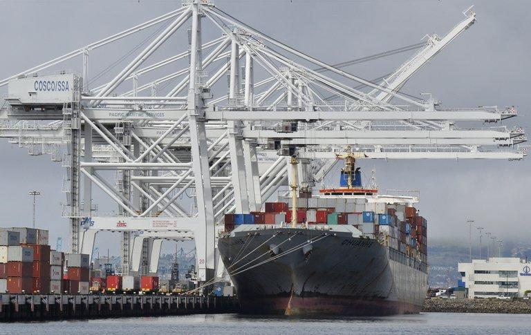 A cargo ship stands on Long Beach harbour, California, on April 26, 2012