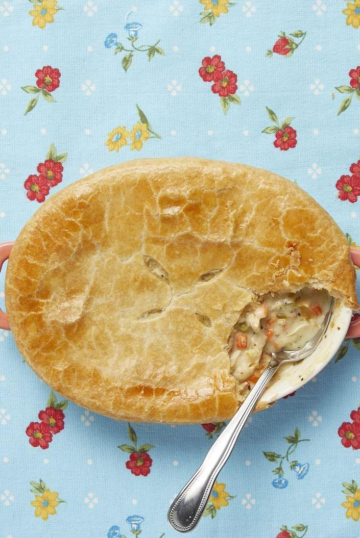 """<p>The flaky crust on top of this creamy chicken pot pie is just heavenly. You'll wonder why you don't make this for dinner <em>every </em>night!</p><p><strong><a href=""""https://www.thepioneerwoman.com/food-cooking/recipes/a11686/pot-pie/"""" rel=""""nofollow noopener"""" target=""""_blank"""" data-ylk=""""slk:Get the recipe."""" class=""""link rapid-noclick-resp"""">Get the recipe.</a></strong></p><p><strong><a class=""""link rapid-noclick-resp"""" href=""""https://go.redirectingat.com?id=74968X1596630&url=https%3A%2F%2Fwww.walmart.com%2Fip%2FThe-Pioneer-Woman-Fiona-Floral-2-Piece-Ceramic-Oval-Bakers-Set%2F292332280&sref=https%3A%2F%2Fwww.thepioneerwoman.com%2Ffood-cooking%2Fmeals-menus%2Fg32933285%2Fcomfort-food-recipes%2F"""" rel=""""nofollow noopener"""" target=""""_blank"""" data-ylk=""""slk:SHOP BAKING DISHES"""">SHOP BAKING DISHES</a></strong> </p>"""