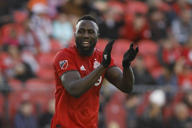 Toronto FC forward Jozy Altidore reacts after a shot on goal against the Columbus Crew during the second half of an MLS soccer match in Toronto, Sunday, Oct. 6, 2019. (Cole Burston/The Canadian Press via AP)