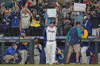 Seattle Mariners third baseman Kyle Seager holds up third base after it was given to him when he was subbed out of a baseball game against the Los Angeles Angels during the ninth inning, Sunday, Oct. 3, 2021, in Seattle. (AP Photo/Ted S. Warren)
