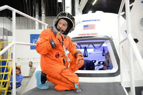 NASA astronaut Randy Bresnik prepares to enter the CST-100 spacecraft, which was built inside The Boeing Company's Houston Product Support Center. Image released July 22, 2013.