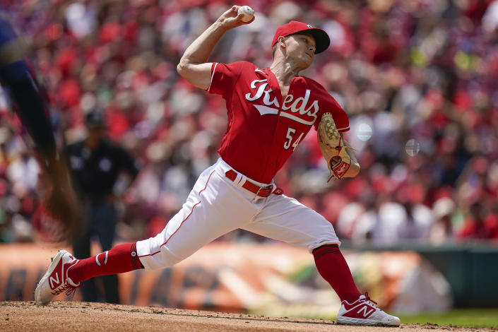 Cincinnati Reds pitcher Sonny Gray (54) throws during the first inning of a baseball game against the Milwaukee Brewers in Cincinnati, Sunday, July 18, 2021. (AP Photo/Bryan Woolston)