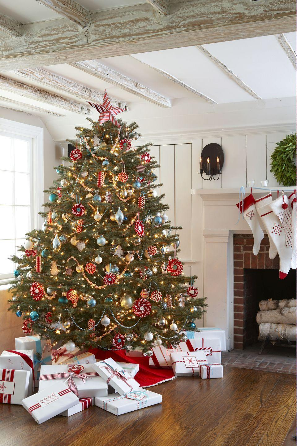 """<p>Aqua accents take the <a href=""""https://www.goodhousekeeping.com/holidays/christmas-ideas/how-to/g1759/red-and-white-christmas-decorations/"""" rel=""""nofollow noopener"""" target=""""_blank"""" data-ylk=""""slk:traditional color combo"""" class=""""link rapid-noclick-resp"""">traditional color combo</a> to the next level. Tape together garlands of <a href=""""https://www.amazon.com/SweetGourmet-Arcor-Starlight-Peppermint-Pinwheel/dp/B004QLRW50/?tag=syn-yahoo-20&ascsubtag=%5Bartid%7C10055.g.2707%5Bsrc%7Cyahoo-us"""" rel=""""nofollow noopener"""" target=""""_blank"""" data-ylk=""""slk:wrapped mints"""" class=""""link rapid-noclick-resp"""">wrapped mints</a> and hang old-school <a href=""""https://www.amazon.com/Thin-Peppermint-Ribbon-Candy-Sevignys/dp/B0006UBMCO?tag=syn-yahoo-20&ascsubtag=%5Bartid%7C10055.g.2707%5Bsrc%7Cyahoo-us"""" rel=""""nofollow noopener"""" target=""""_blank"""" data-ylk=""""slk:ribbon candy"""" class=""""link rapid-noclick-resp"""">ribbon candy</a> to make things even sweeter. </p>"""