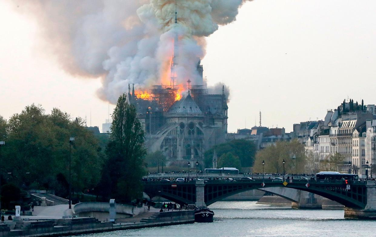 Smokes ascends as flames rise during a fire at the landmark Notre-Dame Cathedral in central Paris on April 15, 2019 afternoon, potentially involving renovation works being carried out at the site, the fire service said. (Photo: Francois Guillot/AFP/Getty Images)