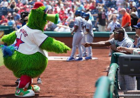 Aug 6, 2015; Philadelphia, PA, USA; Los Angeles Dodgers right fielder Yasiel Puig (66) jokes around with the Phillie Phanatic before the start of the game at Citizens Bank Park. Mandatory Credit: Bill Streicher-USA TODAY Sports