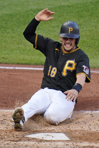 Pittsburgh Pirates' John Ryan Murphy scores one of three runs on a single by Ke'Bryan Hayes off St. Louis Cardinals starting pitcher Carlos Martinez during the fourth inning of the first baseball game of a doubleheader in Pittsburgh, Friday, Sept. 18, 2020. (AP Photo/Gene J. Puskar)