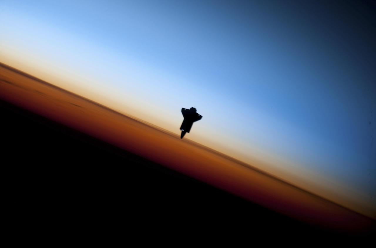 The space shuttle Endeavour is silhouetted against the backdrop of Earth's horizon prior to docking with the International Space Station in this picture taken by an Expedition 22 crew member on February 9, 2010 and released by NASA February 12, 2010.   REUTERS/NASA Handout  (UNITED STATES - Tags: SCI TECH IMAGES OF THE DAY) FOR EDITORIAL USE ONLY. NOT FOR SALE FOR MARKETING OR ADVERTISING CAMPAIGNS