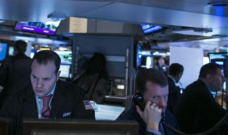 Traders work on the floor of the New York Stock Exchange January 10, 2014. REUTERS/Brendan McDermid