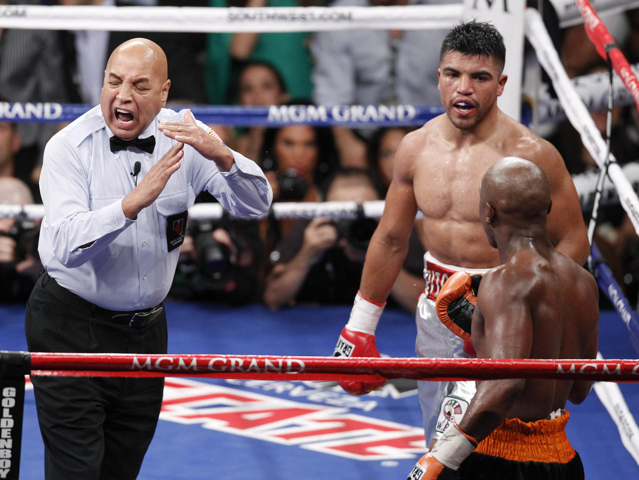 Referee Joe Cortez calls time after Victor Ortiz, top right, head butted Floyd Mayweather in the fourth round during a WBC welterweight title fight, Saturday, Sept. 17, 2011, in Las Vegas. Mayweather won by knockout in the fourth round. (AP Photo/Eric Jamison)