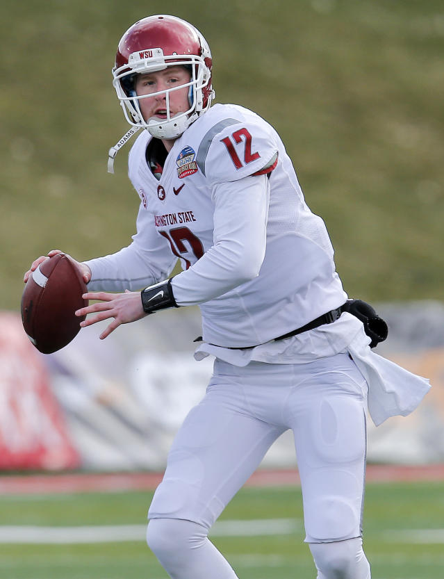 Washington State quarterback Connor Halliday (12) looks to throw against Colorado State during the first half of the NCAA New Mexico Bowl college football game on Saturday, Dec. 21, 2013, in Albuquerque, N.M. (AP Photo/Matt York)
