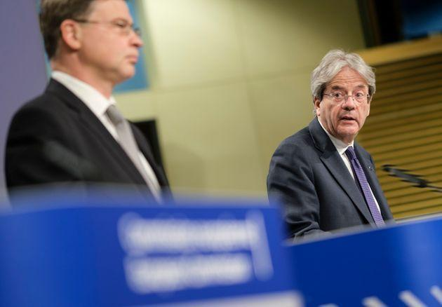 BRUSSELS, BELGIUM - MAY 18: EU Commissioner for An Economy That Works for People - Executive Vice President Valdis Dombrovskis (L) and the EU Commissioner for Economy Paolo Gentiloni (R) talk to the media in the Berlaymont, the EU Commission headquarter on May 18, 2021 in Brussels, Belgium. The European Commission has today adopted a Communication on Business Taxation for the XXI century to promote a robust, efficient and fair business tax system in the European Union. It sets out both a long-term and short-term vision to support Europe's recovery from the COVID-19 pandemic and to ensure adequate public revenues over the coming years. It aims to create an equitable and stable business environment, which can boost sustainable and job-rich growth in the EU and increase our open strategic autonomy. The Communication takes account of the progress made in the G20/OECD discussions on global tax reform. (Photo by Thierry Monasse/Getty Images) (Photo: Thierry Monasse via Getty Images)