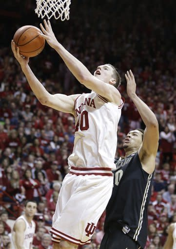 Indiana forward Cody Zeller, left, shoots in front of Purdue center A.J. Hammons in the second half of a NCAA college basketball game in Bloomington, Ind., Saturday, Feb. 16, 2013. Indiana defeated Purdue 83-55. (AP Photo/Michael Conroy)