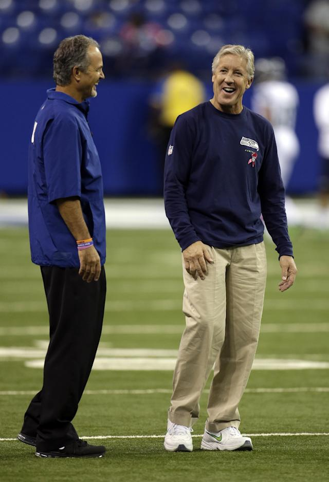 Indianapolis Colts head coach Chuck Pagano, left, talks with Seattle Seahawks head coach Pete Carroll before an NFL football game in Indianapolis, Sunday, Oct. 6, 2013. (AP Photo/AJ Mast)