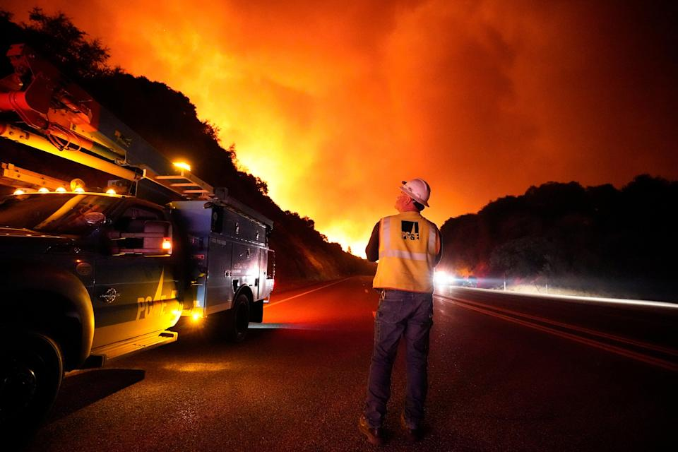 A PG&E electricity worker is seen surveying the Creek Fire, which blazed across swathes of California in September (Copyright 2020 The Associated Press. All rights reserved.)