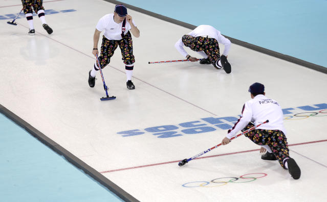 Norway's men's curling team warm up on the curling ice sheet during the first day of training at the 2014 Winter Olympics, Saturday, Feb. 8, 2014, in Sochi, Russia. (AP Photo/Wong Maye-E)