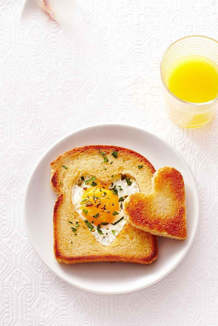 """<p>Show mom how much you love her with a special Mother's Day version of that old brunch standby, egg-in-a-hole, by cutting a heart shape out of the bread. </p><p><a href=""""https://www.womansday.com/food-recipes/food-drinks/recipes/a40385/love-toast-recipe-ghk0215/"""" rel=""""nofollow noopener"""" target=""""_blank"""" data-ylk=""""slk:Get the Love Toast recipe."""" class=""""link rapid-noclick-resp""""><strong><em>Get the Love Toast recipe. </em></strong></a></p>"""