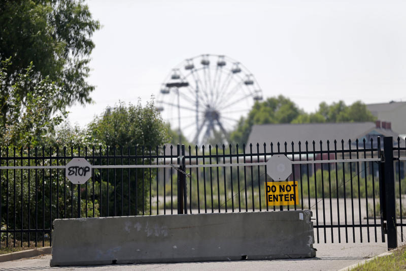 The closed entrance of the former Six Flags Amusement Park is seen in New Orleans, Wednesday, Aug. 28, 2013. The park closed for Hurricane Katrina and never reopened. Thursday is the eighth anniversary of Hurricane Katrina. (AP Photo/Gerald Herbert)