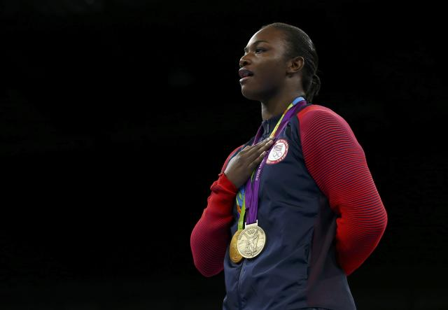 2016 Rio Olympics - Boxing - Victory Ceremony - Women's Middle (75kg) Victory Ceremony - Riocentro - Pavilion 6 - Rio de Janeiro, Brazil - 21/08/2016. Gold medallist Claressa Shields (USA) of USA poses with her medals from London 2012 (purple) and Rio 2016 as she sings the national anthem. REUTERS/Matthew Childs FOR EDITORIAL USE ONLY. NOT FOR SALE FOR MARKETING OR ADVERTISING CAMPAIGNS.