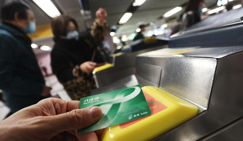 An elderly commuter uses a special Octopus card for discount travel on the MTR. Photo: Jonathan Wong