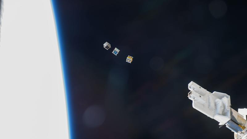 Three Cubesats being deployed from the space station into low-Earth Orbit. image: NASA