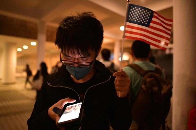 Hong Kong protesters staged a Thanksgiving rally to salute US President Donald Trump for signing legislation supporting them (AFP Photo/Nicolas ASFOURI)