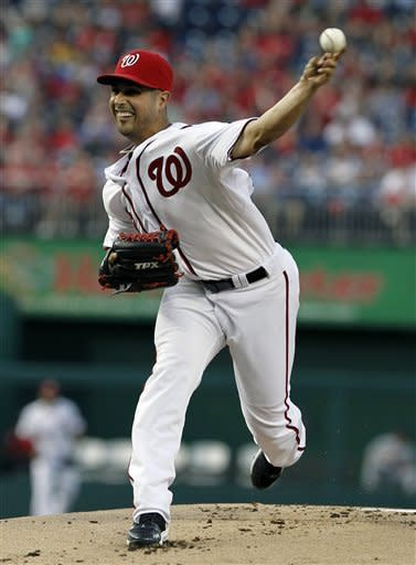 Washington Nationals starting pitcher Gio Gonzalez throws during the first inning of a baseball game against the St. Louis Cardinals at Nationals Park Friday, Aug. 31, 2012, in Washington. (AP Photo/Alex Brandon)