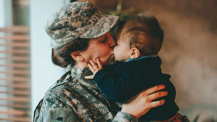 Sad military soldier says goodbye to her son.