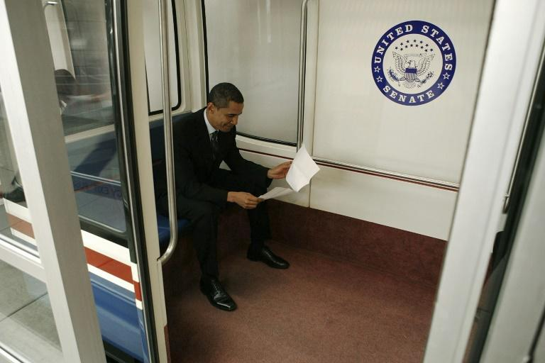 Barack Obama may be one of the world's most famous faces but to his fellow subway passengers in 2007, he was just another senator (AFP/MARK WILSON)