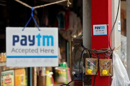 Advertisements of Paytm, a digital wallet company, are seen placed at stalls of roadside vegetable vendors in Mumbai