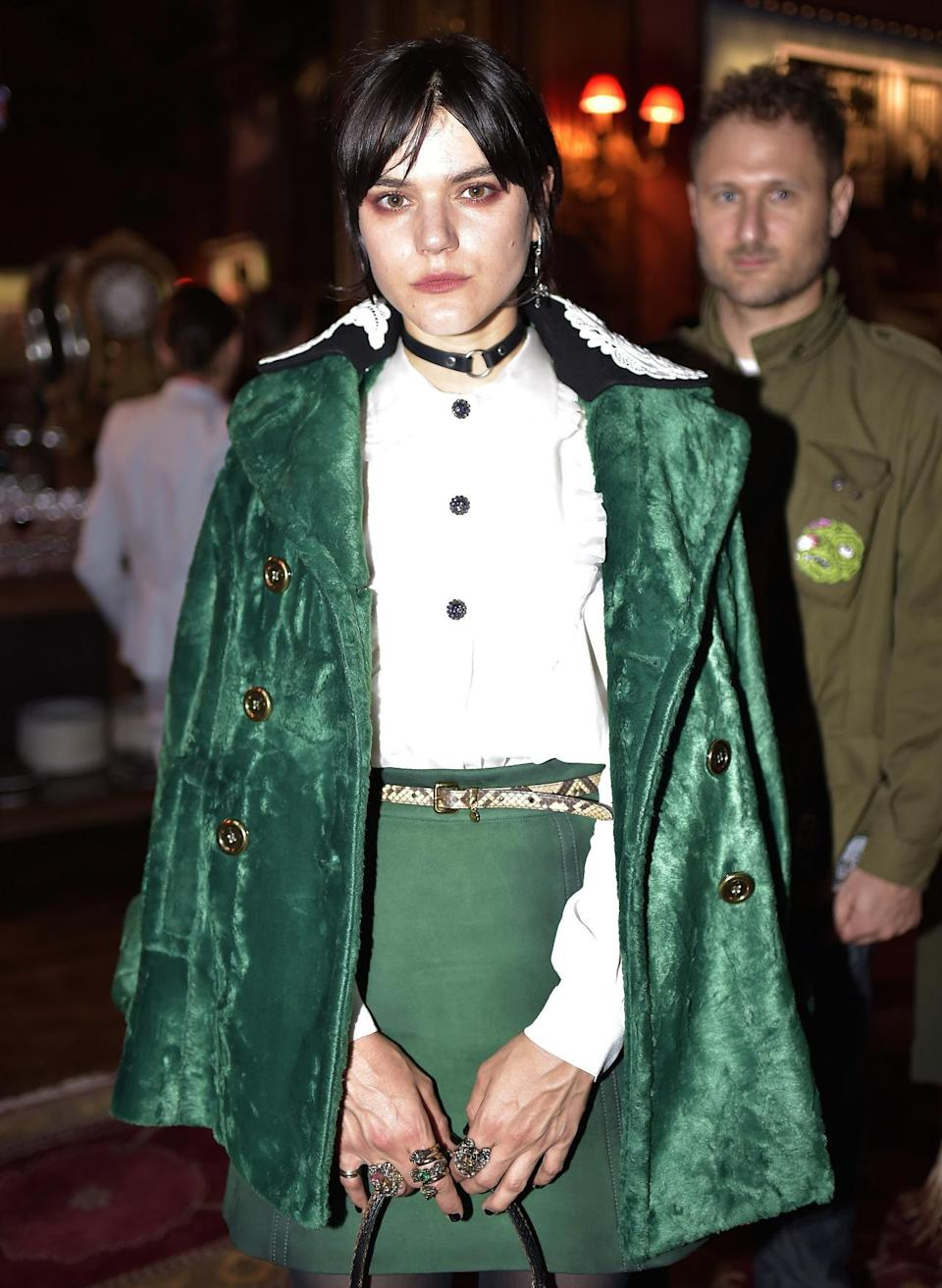 <p>French singer Soko looked very fetching in a green ensemble. <i> [Photo: REX/Shutterstock]</i></p>