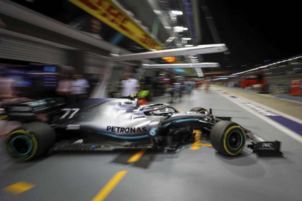 Mercedes driver Valtteri Bottas of Finland pulls out of his garage during the second practice session at the Marina Bay City Circuit ahead of the Singapore Formula One Grand Prix in Singapore, Friday, Sept. 20, 2019. (AP Photo/Vincent Thian)