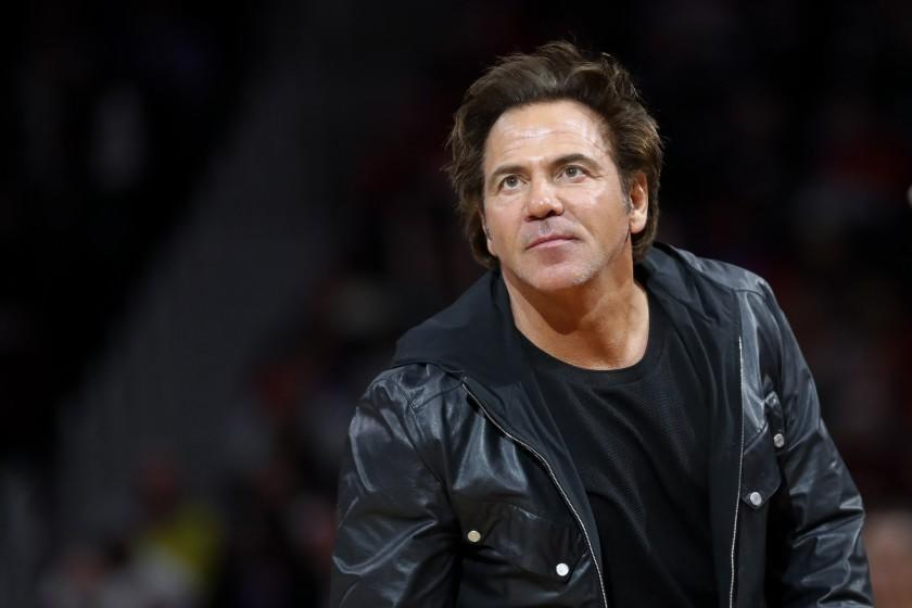 Detroit Pistons owner Tom Gores watches in the second half of an NBA basketball game against the Milwaukee Bucks in Detroit, Tuesday, Jan. 29, 2019. (AP Photo/Paul Sancya)