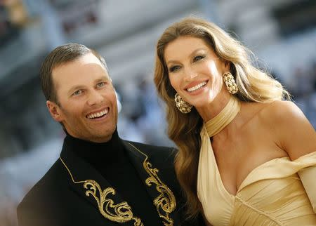"""Tom Brady and Gisele Bundchen arrive at the Metropolitan Museum of Art Costume Institute Gala (Met Gala) to celebrate the opening of """"Heavenly Bodies: Fashion and the Catholic Imagination"""" in the Manhattan borough of New York, U.S., May 7, 2018. REUTERS/Eduardo Munoz"""