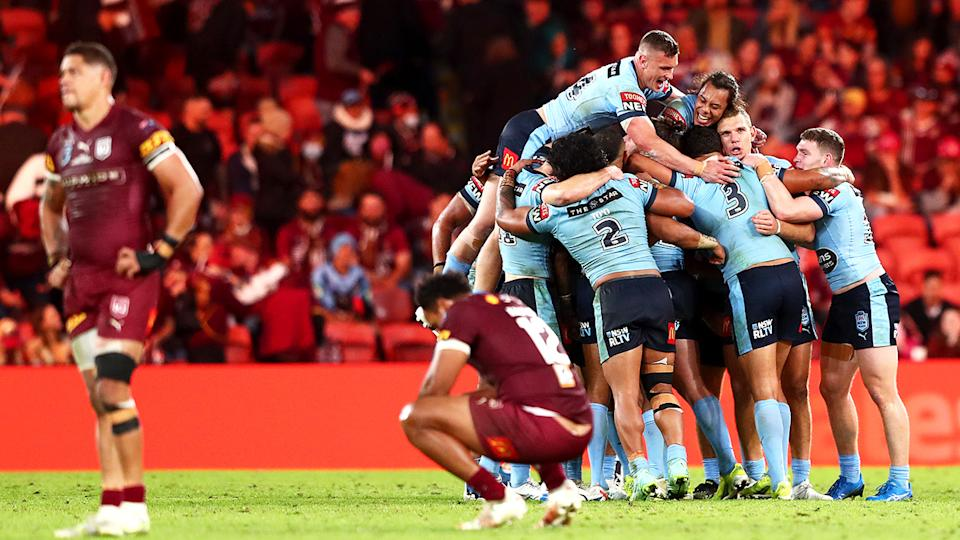 Queensland players were devastated after being held scoreless by NSW in State of Origin II. (Photo by Chris Hyde/Getty Images)